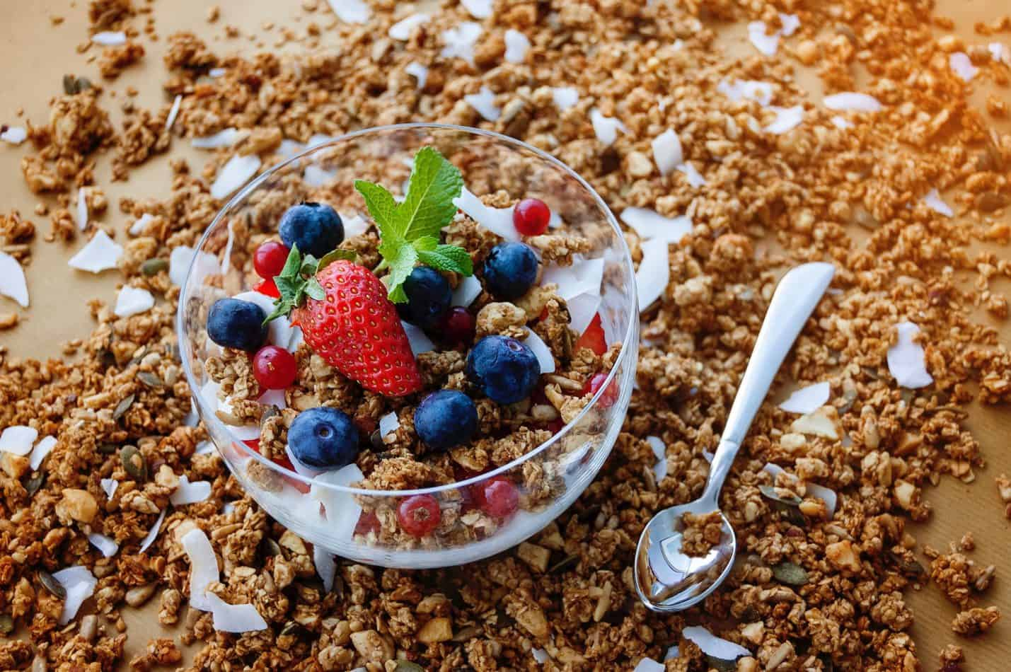 Granola with blueberries, strawberries and mint